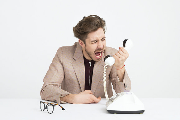 Person shouting at their phone