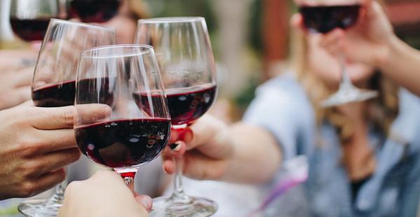 People Chinking Wine Glasses